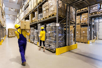 Warehouse worker with box and manager controlling products-1