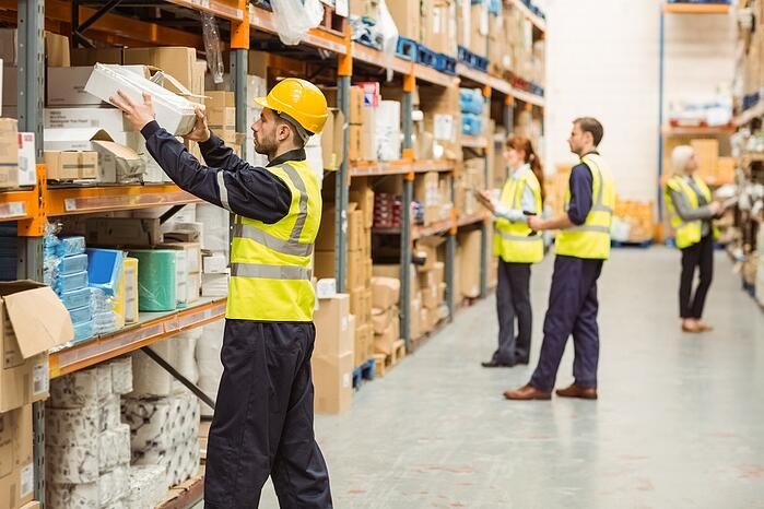 Warehouse worker taking package in the shelf in a large warehouse in a large warehouse-1